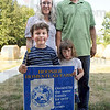 Award: Ben and Monica Poehlein and their two children, Veronica and Luke pose with their Hoosier Homestead Farm sign on their Sullivan County property.