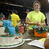 Tribune-Star/Joseph C. Garza<br /> Her cake runneth over: Tressa Steward, 15, enters her waterfall-themed cake into the 4-H fair Saturday at Wabash Valley Fairgrounds.