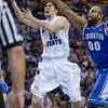 Tribune-Star file photo/Joseph C. Garza<br /> And, one: Indiana State's Jake Odum is fouled by Creighton's Gregory Echenique as he drives to the basket Saturday, Feb. 25 during the Sycamores' 61-60 loss at Hulman Center. Odum made the basket.