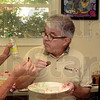 Tribune-Star/Joseph C. Garza<br /> Hey, Kevin, what does the dessert taste like?: Bionca Gambill takes a piece of cookie from Kevin Orpurt's plate as he tastes another piece of dessert during the judging of baked goods Wednesday at the Wabash Valley Fairgrounds. Looking on is First Financial Bank's Sally Whitehurst.