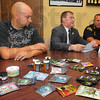 Tribune-Star/Jim Avelis<br /> On the table: Steve Lockard of the Vigo County Drug Task Force, Vigo County Prosecutor and police chief John Plasse sit at a table with packets and containers of synthetic marijuana. A press conference was held regarding the sale of the substances and the danger regarding their use.