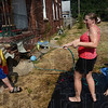 Tribune-Star/Joseph C. Garza<br /> He didn't see it coming: Lacy LaFleur turns the hose on Bobby Tisdale as she fills her children's pool on north Eighth Street Wednesday.