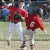 Turn two: Riley's second baseman #19 Matt Wilson fires to first base after forcing out Connorsville's #6 Jordan Cooley.