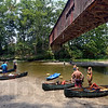 Covered landing: Groups of canoers land under the Cox Ford Bridge at the end of their Monday afternoon trip. Water levels have slowed the normally busy Sugar Valley season.