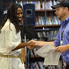 Tribune-Star/Joseph C. Garza<br /> Course completion: Wabash Valley Correctional Facility inmate Kenneth Kelly shakes the hand of Aramark Assistant Food Service Director Jason English as he accepts his course completion certificate Monday at the facility near Carlisle.