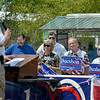 Tribune-Star/Joseph C. Garza<br /> Signs of support: Supporters of Congressman Larry Bucshon listen as he discusses his platform during a campaign stop Monday at the Wabash Valley Fairgrounds.