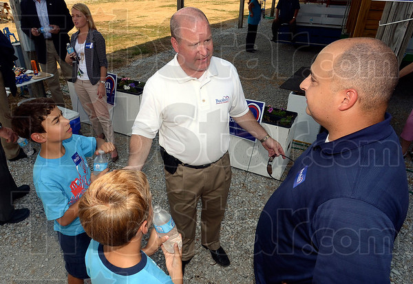 Tribune-Star/Joseph C. Garza<br /> Meet your congressman, kids: Matthew and Samuel Ford listen as Congressman Larry Bucshon talks with their father, Jon Ford, during a campaign stop at the Wabash Valley Fairgrounds Monday.