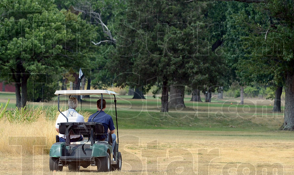 Course inspection: Pyrotechnist Jim Stanfill and Tribune-Star reporter Arthur Foulkes inspect the area where Tuesday's fireworks display at The Landing will be launched.