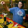 Tribune-Star/Joseph C. Garza<br /> Popular kaboom: Tonya Francis, a manager at USA Fireworks in West Terre Haute, demonstrates how one of the store's most popular items, the Excalibur, is loaded Monday.
