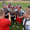Tribune-Star/Joseph C. Garza<br /> The vest of defense: Terre Haute South coach Mark Reitz talks to his defense during the team's first practice Monday at South.