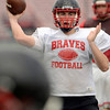 Tribune-Star/Joseph C. Garza<br /> Let the season begin: Terre Haute South's Danny Etling throws a pass to an open teammate during the Braves' first day of practice Monday at South.