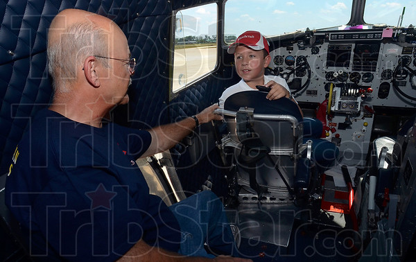 Tribune-Star/Joseph C. Garza<br /> Aviation conversation: Jordan Brown sits in the pilot's seat of the DC-3, Flagship Detroit, as he talks to one of the plane's pilots and crew members, Rick Smail, Tuesday at the Terre Haute International Airport-Hulman Field.