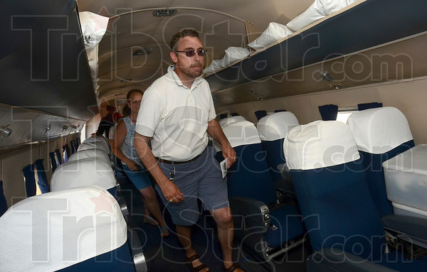 Tribune-Star/Joseph C. Garza<br /> Bit of an uphill climb: J.P. Mellor makes his way to the cockpit of the DC-3 aircraft, Flagship Detroit, Tuesday at the Terre Haute International Airport-Hulman Field.