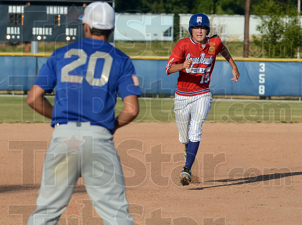 Beat the heat (and the throw): Wayne Newton Post 346's Zach Milam hustles to third base to beat the throw in the first inning of the team's game against Crawfordsville Tuesday at Terre Haute North.