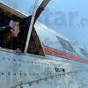 Tribune-Star/Joseph C. Garza<br /> Crew's view: Leona Gibson, 11, enjoys the view from an open window in the midsection of the DC-3, Flagship Detroit, during a tour of the plane Tuesday at the Terre Haute International Airport-Hulman Field.