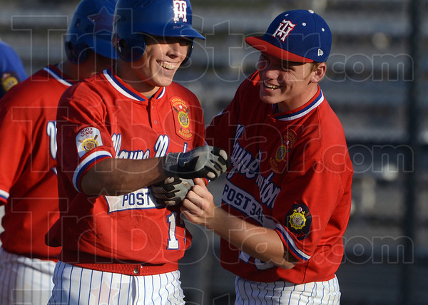 Home run happiness: Tony Rosselli of Wayne Newton Post 346 is congratulated by teammate Bryan Nacke after Rosselli hit a three-run home run in the third inning against Crawfordsville Tuesday at Terre Haute North.