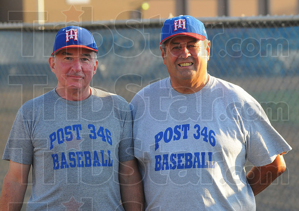Tribune-Star/Jim Avelis<br /> Volunteers: Mike Patrick and Chuck Gross volunteer for the American Legion Post 346 games, helping out where needed.