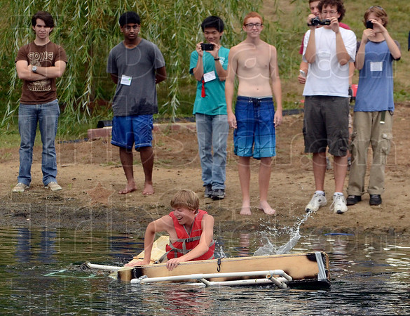 Tribune-Star/Joseph C. Garza<br /> Will it float?: High school student Alek Jansen of Warsaw tries to stay on top of his team's creation as part of the Operation: Catapult program Tuesday at Rose-Hulman Institute of Technology.