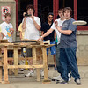 Tribune-Star/Joseph C. Garza<br /> From here...: High School student Max Gordin, far right, of Detroit, launches a disk with his team's project as part of the Operation: Catapult program Tuesday on the campus of Rose-Hulman Institute of Technology.