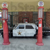 "Tribune-Star/Jim Avelis<br /> Vintage: A vintage Ford police car is part of the hometown feel in downtown Clay City. ""Mayberry of the Midwest"" adorns the door over the star."