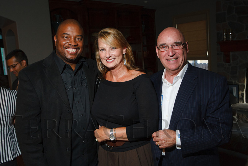 Terrance Carroll with Corinne and Keith Marks.  Historic Elitch Gardens Theatre fundraiser at the home of Jamie Van Leeuwen in Denver, Colorado, on Tuesday, July 10, 2012.<br /> Photo Steve Peterson