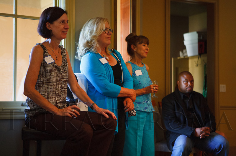 Elisa Speranza, Barb Grogan, Patricia Baca, and Terrence Carroll listen to José Mercado's update on the HEGT.  Historic Elitch Gardens Theatre fundraiser at the home of Jamie Van Leeuwen in Denver, Colorado, on Tuesday, July 10, 2012.<br /> Photo Steve Peterson