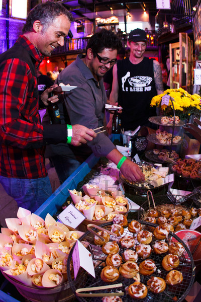 "Eric Jaenike and Jake Ruybal III, from Artistry Events and Design, sample a few desserts created by Epicurean's Kyle Tipton (right).  ""Skin & Bones,"" an event created and hosted by Epicurean Culinary Group, as part of a three-day conference titled ""The Art of Catering FOOD,"" presented by the International Catering Association and Catersource Magazine, at City Hall Event Center in Denver, Colorado, on Monday, July 23, 2012.<br /> Photo Steve Peterson"