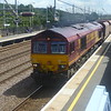 DB Schenker class 66 no. 66095 passes Sandy with a stone train.