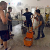 """Volunteers: Marine volunteers Garrett Johnson, Austin Hardos and Caleb Mason get instructions from Ross Harpole Tuesday as they volunteer to help clean and prepare the """"Y"""" for opening."""