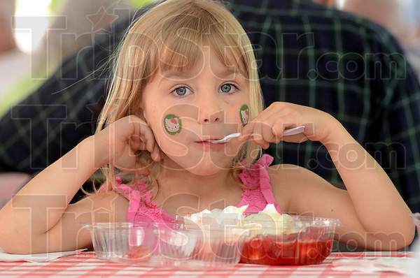Tribune-Star/Jim Avelis<br /> Hello strawberry: Five-year-old Lizzy Revell savors a a mouthfull of strawberry shortcake at the Annual First Congregational Church Strawberry Festival Thursday afternoon. She was there with her mom Chrissy.