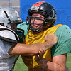 Tribune-Star/Joseph C. Garza<br /> On the line: West Vigo's Harley Elkins, right, tangles with an offensive lineman during practice for the Wabash Valley Football Coaches Association game Thursday at Memorial Stadium.