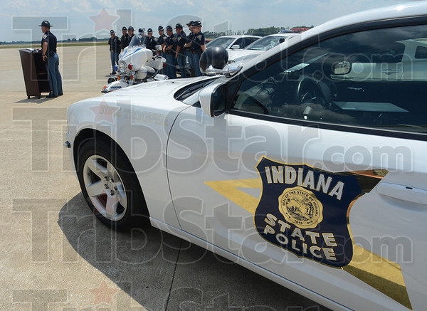 Tribune-Star/Jim Avelis<br /> Recognizable: Indiana State police troopers attended a press conference Thursday afternoon along with their vehicles. The troopers use marked and unmarked cars, a pickup truck, a motorcycle and an airplane in their course of duty.