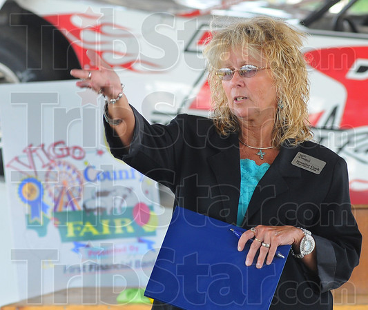 Tribune-Star/Jim Avelis<br /> Introducing: Jennifer Cook, President of the Wabash Valley Fair Association, introduces Board members at the fairgrounds Thursday evening. A Media Night as held to get the 2012 Vigo County Fair  publicized.