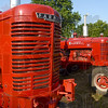Tribune-Star/Joseph C. Garza<br /> Our farming heritage: Classic and antique tractors are parked in a line Saturday for display at the Wabash Valley Fairgrounds for the start of the Vigo County Fair.