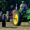 Tribune-Star/Joseph C. Garza<br /> Classic J.D. Green: Eddie McCullough positions his 1951 John Deere B into a spot in a row of tractors Saturday at the Wabash Valley Fairgrounds.