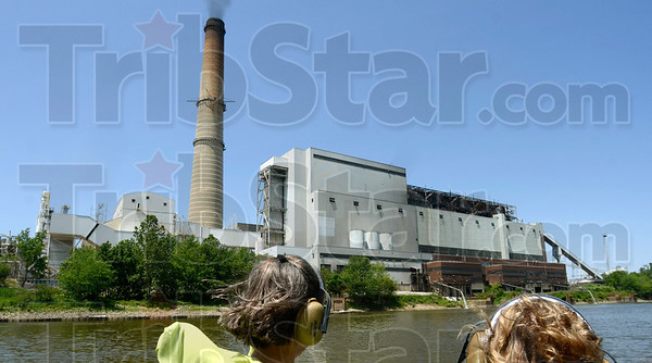 Tribune-Star/Joseph C. Garza<br /> Pollutant problems: Members of the Nature Conservancy pass by the Duke Energy Wabash River Station May 15 north of the city.