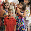 Awe: Members of the Central Presbyterian Church children's choir react to the dedication of the stained glass windows during Sunday's service.