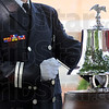 Toll: Capt. Russell Feuquay rings the bell for each fallen hero during Sunday's event at the Police and Fire Museum.