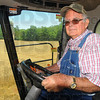 Tribune-Star/Jim Avelis<br /> Bringing in the wheat: Mike Warner runs a combine, harvesting Roger Sturgeon's wheat on land north of Riley.
