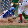 Tribune-Star/Joseph C. Garza<br /> Avoided the tag: Wayne Newton Post 346 catcher Preston Tofaute tries to tag Evansville Pate Post 265's Reid Haefner in time at home plate as teammate and pitcher Kodie Girton looks on during Post 346's loss Sunday at Terre Haute North High School.