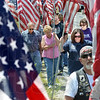 Stars and stripes: Hundreds of volunteers helped install Flags to honor fallen soldier Spc. Arronn Fields Sunday afternoon on SR 340 near the Clearview Cemetery. .