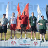 Tribune-Star/Jim Avelis<br /> Winners all: Special Olympics competitors in the shot put take to the podium Sunday morning to receive their medals and ribbons.