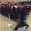 Tribune-Star/Jim Avelis<br /> Moving on: Terre Haute North Vigo High School students file into Hulman Center for their graduation Sunday afternoon. Some 400 students graduated.