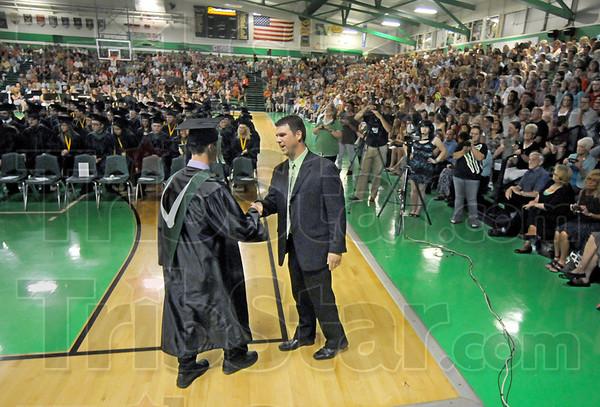 Congrats: West Vigo Principal Thomas Balitewicz shakes hands and congratulates each graduating senior during 2012 Commencement exercises.