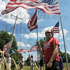 Volunteers: Several volunteers carry flags along SR 340 in clay County preparing for the funeral of Spc. Arronn Fields Sunday afternoon.