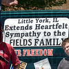Sign: A Little York, Ill. resident displays a sympathy sign on a vehicle at Sunday's gathering of volunteers.