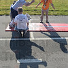Tribune-Star/Jim Avelis<br /> Leaper: Wesley Grubb of New Castle takes his turn at the standing long jump in Special Olympics competition Sunday June 3,2012. The three day competition in Terre Haute ended by noon.