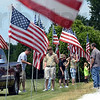 Prepared: A group of Boy Scouts and volunteers install a line of flags inside the Clearview Cemetery in Clay County where Spc. Arronn Fields will be laid to rest Tuesday.