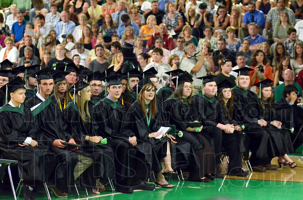 Graduates: West Vigo students that have already received their diplomas watch as fellow students receive theirs during Sunday's Commencement ceremony. The West Vigo gym was standing room only during the event.