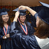 Tribune-Star/Jim Avelis<br /> Just right: Jessica Stoelting watches Jenny Stone get her tassel adjusted by classmate Heather Sturm before their graduation ceremony Sunday afternoon.